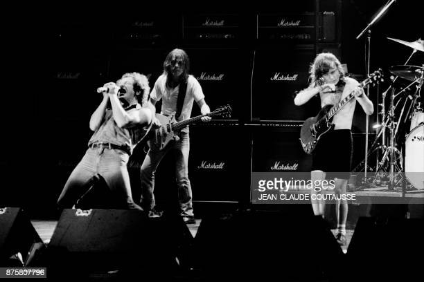 Singer Brian Johnson performs next to guitarists Malcolm Young and Angus Young of Australian legendary hard rock band AC/DC at the Palais Omnisport...