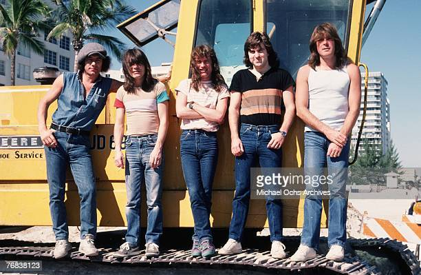 Singer Brian Johnson rhythm guitarist Malcolm Young lead guitarist Angus Young drummer Simon Wright and bassist Cliff Williams of AC/DC pose on a...