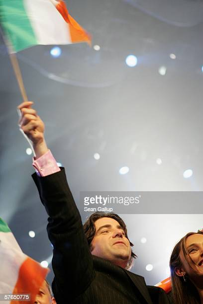 Singer Brian Kennedy of Ireland celebrates while holding an Irish flag after he made it into the finals after the semifinals of the 2006 Eurovision...