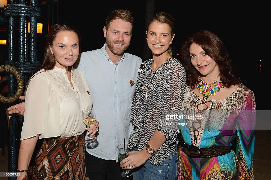 Singer Brian McFadden (2nd L) and his wife, Vogue Williams (2nd R) attend the official welcome function ahead of the Gary Player Invitational presented by Coca-Cola at The Palace Hotel and The Lost City Golf Course on November 14, 2013 in Sun City, South Africa.