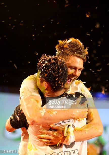 Singer Brian McFadden hugs Emmanuel Rodriguez of Justice Crew after getting slimed during the matinee Nickelodeon Slimefest 2012 show at Hordern...