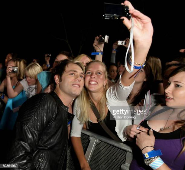 Singer Brian McFadden poses with fans at the MTV Australia Awards 2008 at the Australian Technology Park, Redfern on April 26, 2008 in Sydney,...