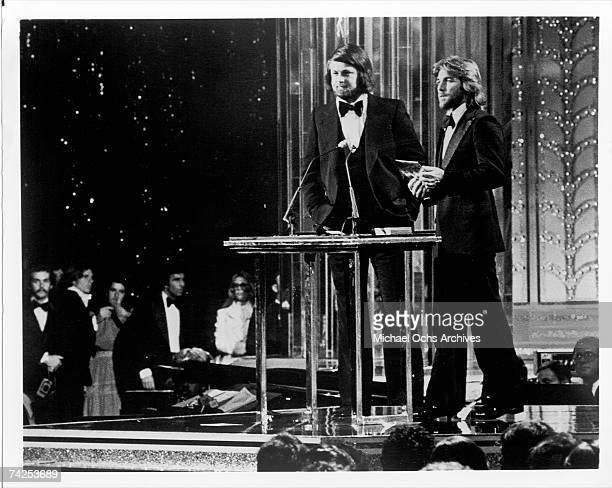 Singer Brian Wilson and drummer Dennis Wilson of the rock and roll band The Beach Boys present an award on Don Kirshner's Rock Music Awards Show at...