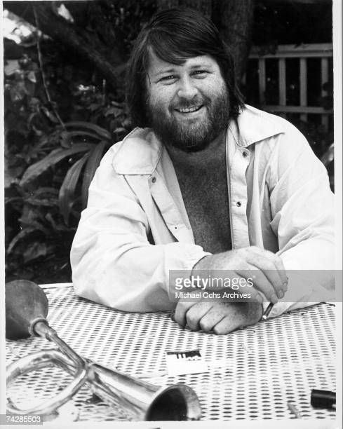 Singer Brian Wilson of the rock and roll band The Beach Boys sits at a patio table in 1976 in Los Angeles California