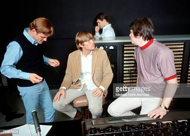 """Singer Brian Wilson of the rock and roll band """"The Beach Boys"""" talks to engineers and other on-lookers while recording the album """"Pet Sounds"""" in 1966..."""