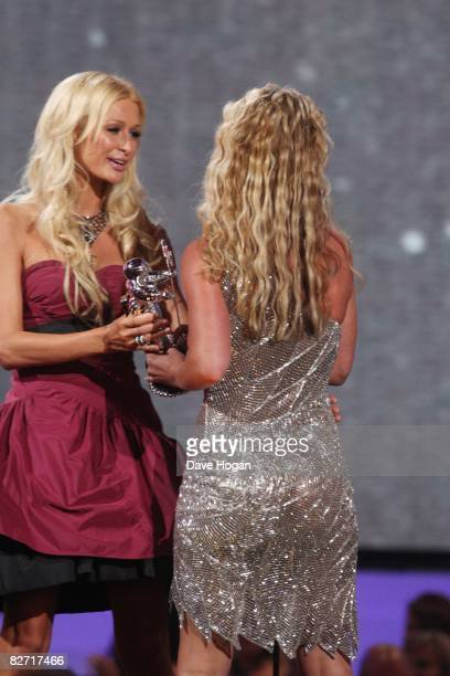 Singer Britney Spears accepts an award from Paris Hilton at the 2008 MTV Video Music Awards on the Paramount Studios lot on September 7 2008 in Los...