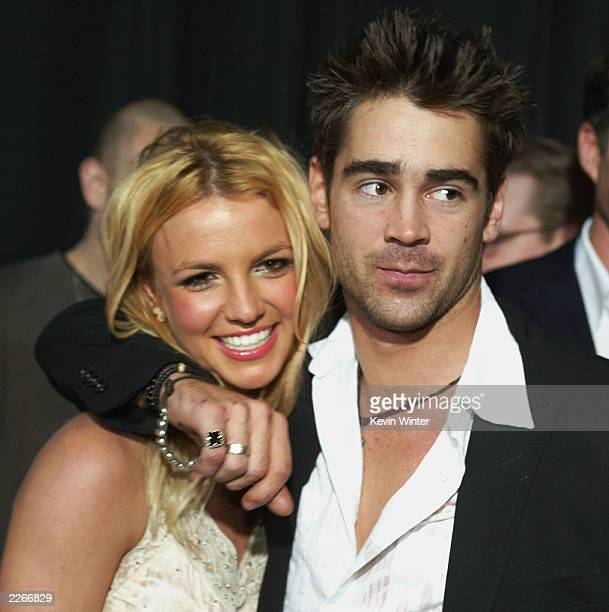 Singer Britney Spears and actor Colin Farrell arrive at the premiere of 'The Recruit' at the Cinerama Dome on January 28 2003 in Hollywood California