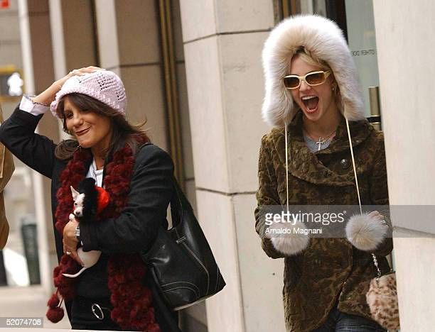 Singer Britney Spears and her mother Lynne Spears wear the new hats they bought at Barneys New York as they leave the store on December 13 2004 in...
