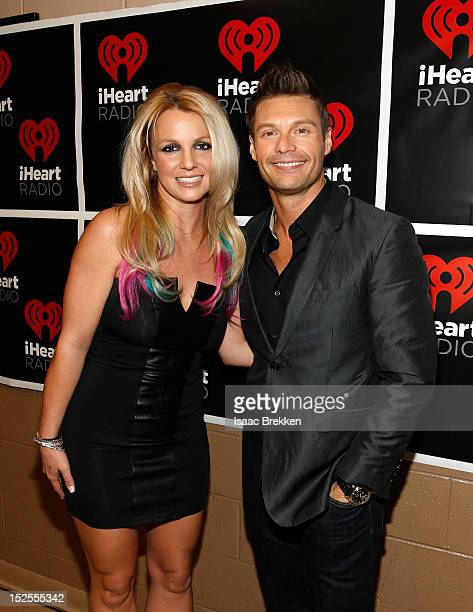 Singer Britney Spears and host Ryan Seacrest pose backstage during the 2012 iHeartRadio Music Festival at MGM Grand Garden Arena on September 21,...