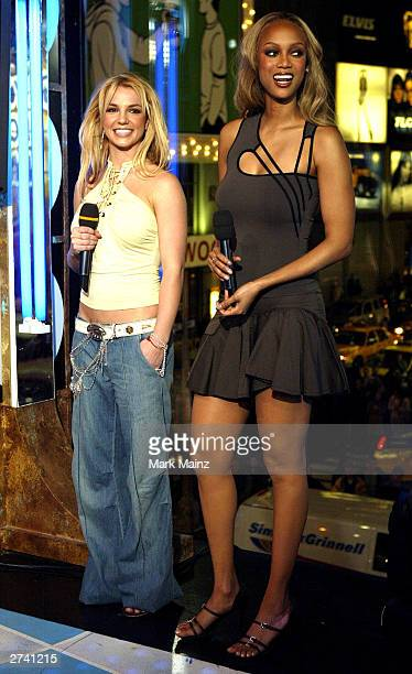 "Singer Britney Spears and supermodel Tyra Banks appear on stage during ""Spanking New Music Week"" on MTV Total Request Live at the MTV Times Square..."