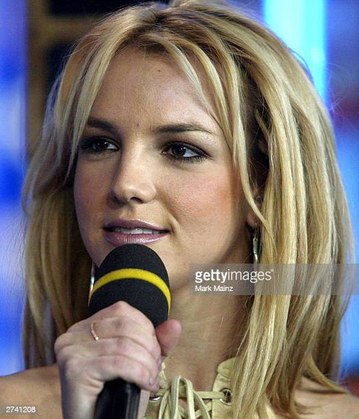 "Singer Britney Spears appears on stage during ""Spanking New Music Week"" on MTV Total Request Live at the MTV Times Square Studios November 18, 2003..."