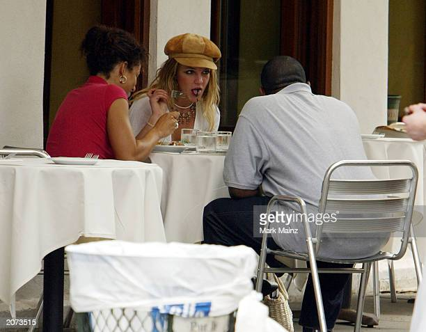 Singer Britney Spears eats lunch with some unidentified friends in SoHo June 11 2003 in New York City