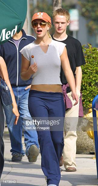 Singer Britney Spears enjoys a lollipop during an afternoon stroll on October 13 2002 in West Hollywood California