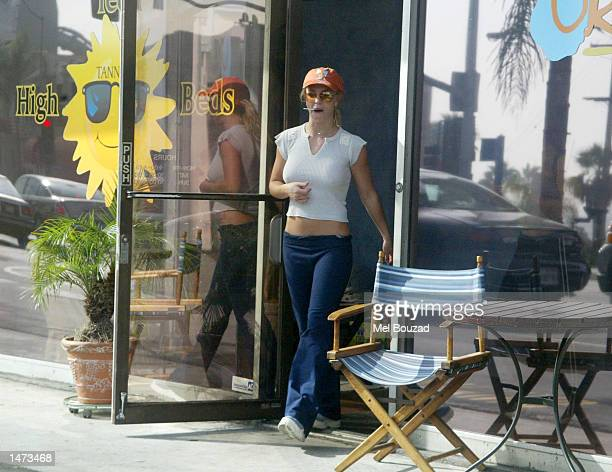 Singer Britney Spears exits a tanning salon shop on October 13 2002 in West Hollywood California
