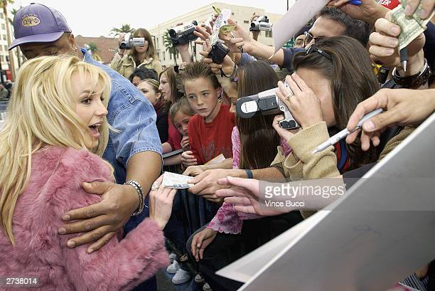 Singer Britney Spears greets fans at a ceremony honoring her with a star on the Hollywood Walk of Fame on November 17 2003 on Hollywood Boulevard in...