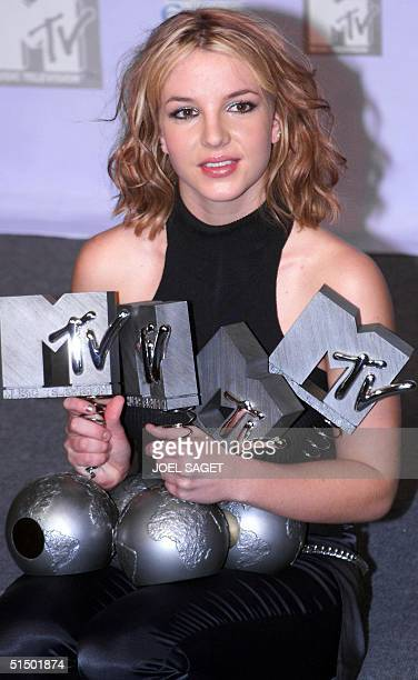 US singer Britney Spears holds her awards for Best Female Best Pop Best Song and Best Breakthrough performer for the 1999 MTV Europe Awards at The...