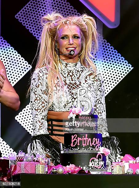 Singer Britney Spears is presented with a birthday cake onstage during 102.7 KIIS FM's Jingle Ball 2016 presented by Capital One at Staples Center on...