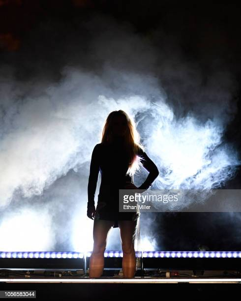 Singer Britney Spears is silhouetted as she attends the announcement of her new residency Britney Domination at Park MGM on October 18 2018 in Las...