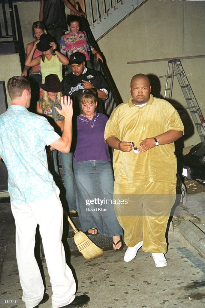 Singer Britney Spears (2nd from L) leaves the Latin Lounge with her entourage on August 2, 2002 in West Hollywood, California.