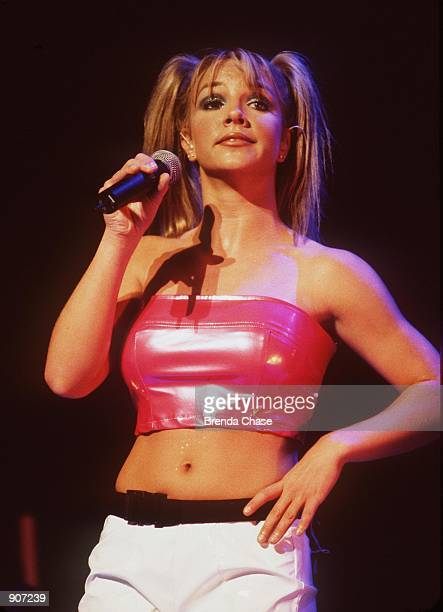 "Singer Britney Spears performs July 31, 1999 at the Universal Ampitheater in Universal City, CA during her ""Baby One More Time"" tour. The British..."