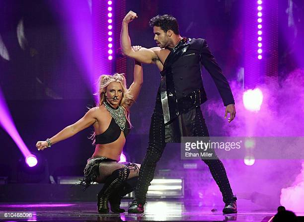Singer Britney Spears performs with a dancer at the 2016 iHeartRadio Music Festival at TMobile Arena on September 24 2016 in Las Vegas Nevada