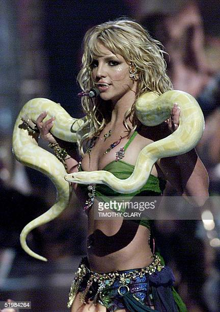 Singer Britney Spears performs with a snake draped over her neck at the 2001 MTV Video Music Awards 06 September in New York