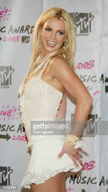 Singer Britney Spears poses backstage during the 2003 MTV Video Music Awards at Radio City Music Hall on August 28 2003 in New York City