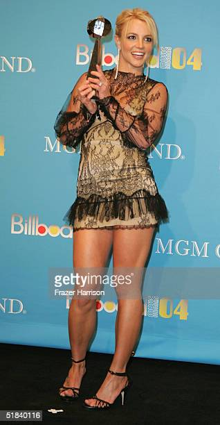 Singer Britney Spears poses with her Hot Dance Sales Single of the Year award for 'Me Against The Music' at the 2004 Billboard Music Awards at the...