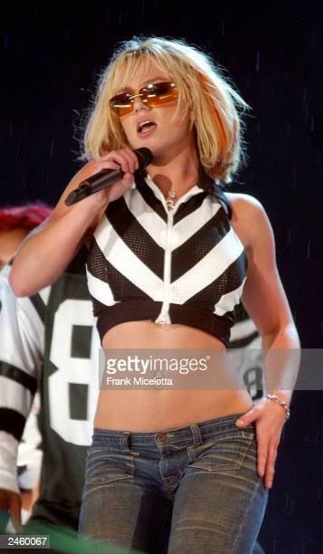 Singer Britney Spears rehearses for the 2003 'NFL Kickoff Live from the National Mall' September 3 2003 in Washington DC Thousands of US military...