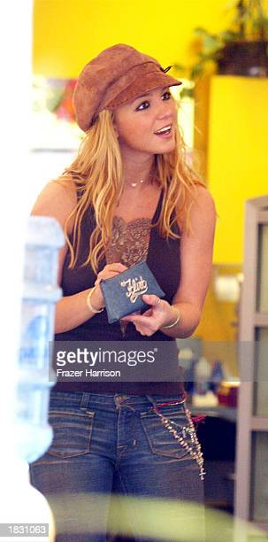 Singer Britney Spears shops for eyeglasses on Melrose Avenue on March 5 2003 in Los Angeles California