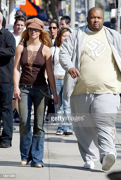 Singer Britney Spears shops with her bodyguard Big Rob on Melrose Avenue on March 5 2003 in Los Angeles California