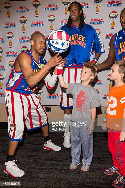 Singer Britney Spears sons Sean Federline and Jayden James Federline with Harlem Globetrotters Scooter Stretch and Big Easy at Staples Center on...