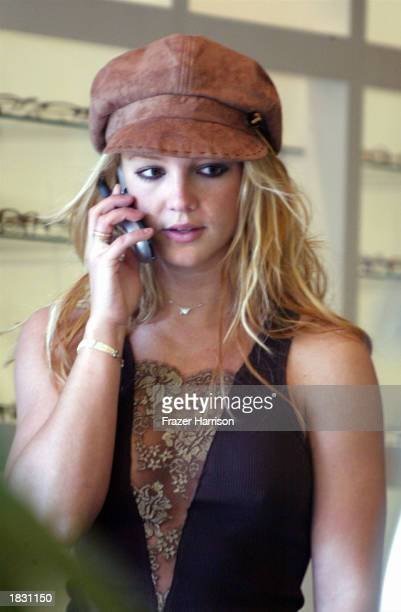 Singer Britney Spears talks on her mobile phone while shopping for eyeglasses on Melrose Avenue on March 5 2003 in Los Angeles California