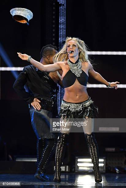 Singer Britney Spears throws her hat as she performs at the 2016 iHeartRadio Music Festival at TMobile Arena on September 24 2016 in Las Vegas Nevada