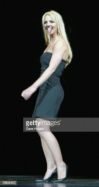 Singer Britney Spears walks on stage for the launch of Pepsi's new TV commercial at the Dominion Theatre on January 26 2004 in London The...