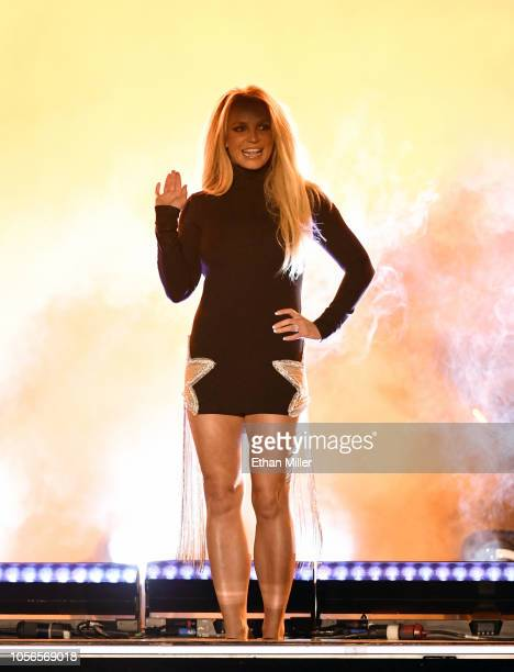 Singer Britney Spears waves as she attends the announcement of her new residency Britney Domination at Park MGM on October 18 2018 in Las Vegas...