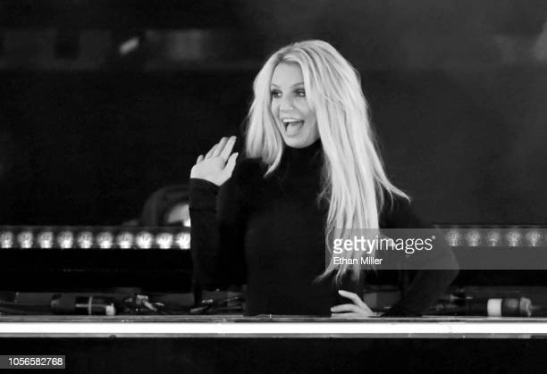 "Singer Britney Spears waves as she attends the announcement of her new residency, ""Britney: Domination"" at Park MGM on October 18, 2018 in Las Vegas,..."