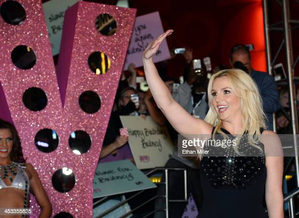 Singer Britney Spears waves at a welcome ceremony as she celebrates the release of her new album 'Britney Jean' and prepares for her twoyear...