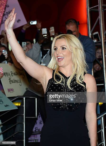 Singer Britney Spears waves at a welcome ceremony as she celebrates the release of her new album Britney Jean and prepares for her twoyear residency...