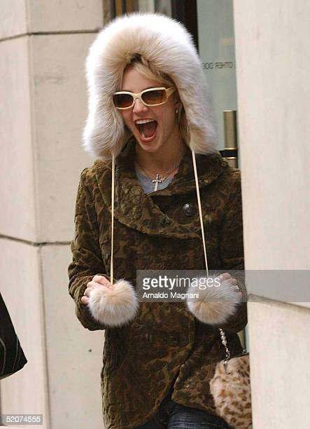 Singer Britney Spears wears the new hat she bought at Barneys New York as she leaves the store on December 13 2004 in New York City