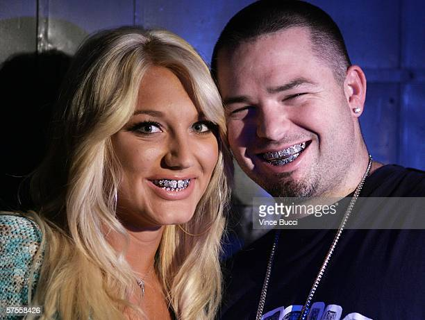 Singer Brooke Hogan and rap musician Paul Wall pose on the set of her music video shoot 'Bout Us' on May 7 2006 in Los Angeles California
