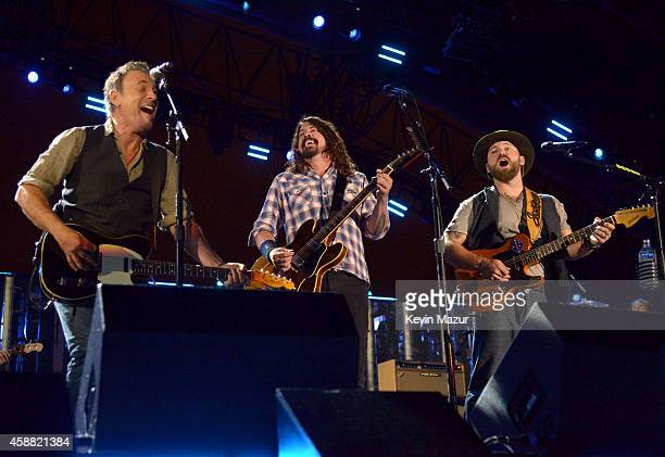 Singer Bruce Springsteen musician Dave Grohl and musician Zac Brown perform onstage during The Concert For Valor at The National Mall on November 11...
