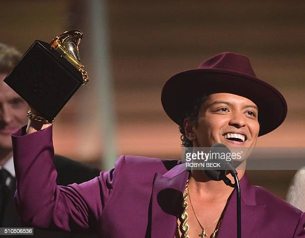 Singer Bruno Mars holds up the award for the Record of the Year, Uptown Funk onstage during the 58th Annual Grammy music Awards in Los Angeles...