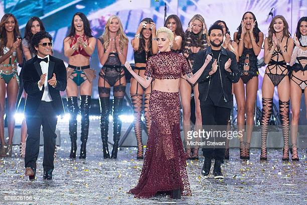 Singer Bruno Mars Lady Gaga and The Weeknd perform during the runway during the 2016 Victoria's Secret Fashion Show at Le Grand Palais in Paris on...