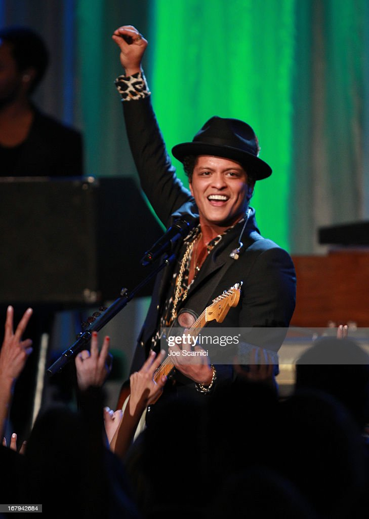 "Singer Bruno Mars performs onstage at EIF Women's Cancer Research Fund's 16th Annual ""An Unforgettable Evening"" presented by Saks Fifth Avenue at the Beverly Wilshire Four Seasons Hotel on May 2, 2013 in Beverly Hills, California."