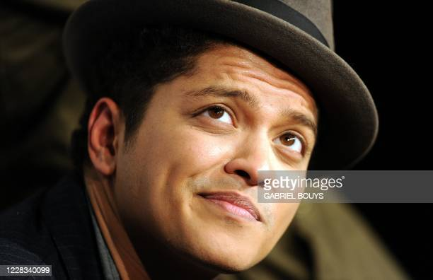 Singer Bruno Mars poses in the press room at the Grammy Nominations Concert December 1 2010 at Club Nokia in downtown Los Angeles The 53rd annual...