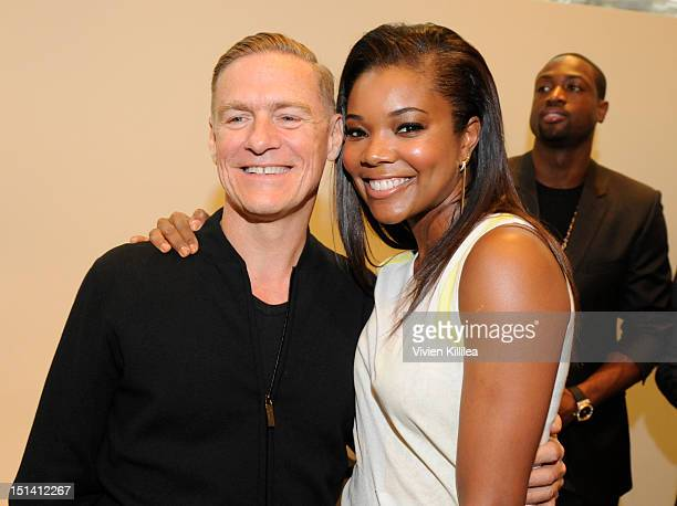 Singer Bryan Adams and actress Gabrielle Union attend Calvin Klein Collection Celebrates Fashion's Night Out 2012 at Calvin Klein Boutique on...
