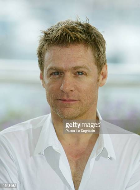 """Singer Bryan Adams pauses outside the screening of the animated film, """"Spirit the Stallion of the Cimarron"""" May 18, 2002 at the 55th International..."""