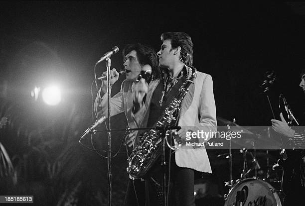 Singer Bryan Ferry and saxophonist Andy Mackay performing with English rock group Roxy Music UK November 1973 Bassist John Gustafson is at far right