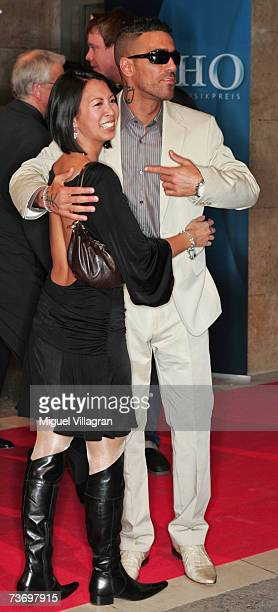 Singer Bushido and MinhKhai PhanThi arrive at the ECHO Music Awards on March 25 2007 in Berlin Germany